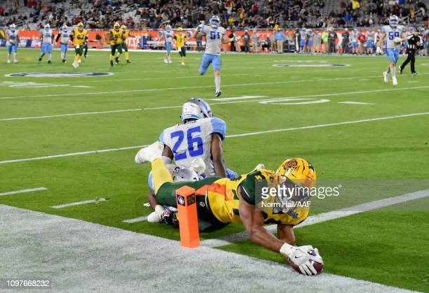 Jhurell Pressley of the Arizona Hotshots scores a touchdown behind Will Davis#26 of the Salt Lake Stallions during the second half of the Alliance of...