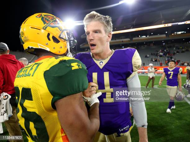 Jhurell Pressley of the Arizona Hotshots shakes hands with Matt Simms of the Atlanta Legends after the Legends defeated the Hotshots 1411 in the...