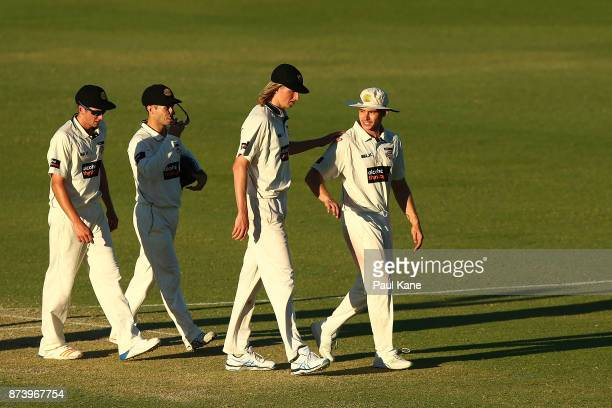 Jhye Richardson Jonathan Wells David Moody and Andrew Holder of Western Australia walk from the field at stumps during day two of the Sheffield...