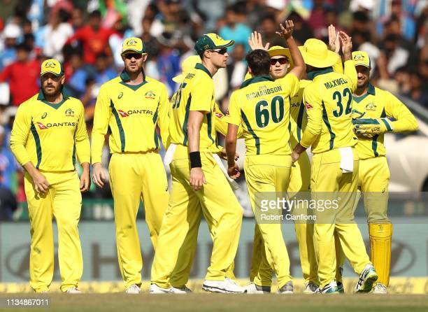 Jhye Richardson of Australia celebrates taking the wicket of Rohit Sharma of India during game four of the One Day International series between India...