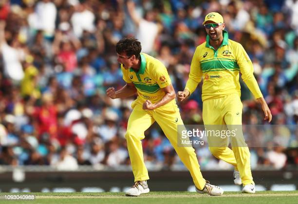 Jhye Richardson of Australia celebrates taking the wicket of Virat Kohli of India during game one of the One Day International series between...