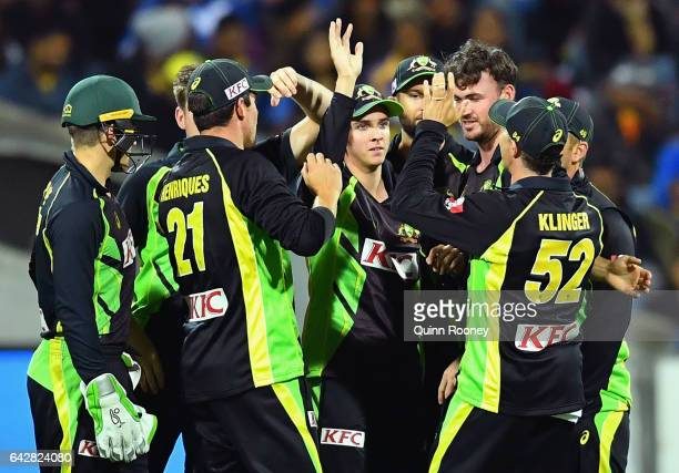 Jhye Richardson of Australia is congratulated by team mates after taking a catch to dismiss Upul Tharanga of Sri Lanka during the second...
