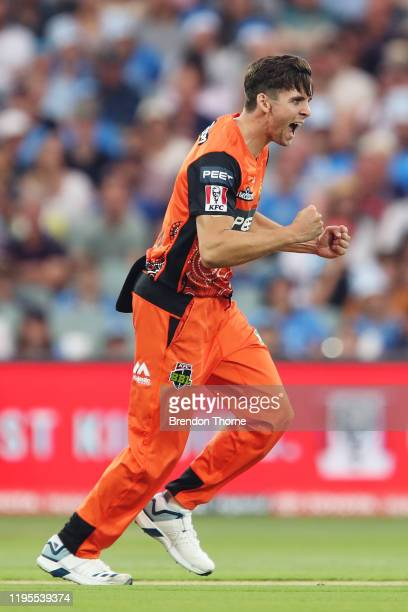 Jhye Richardson of the Scorchers celebrates after claiming the wicket of Phil Salt of the Strikers during the Big Bash League match between the...