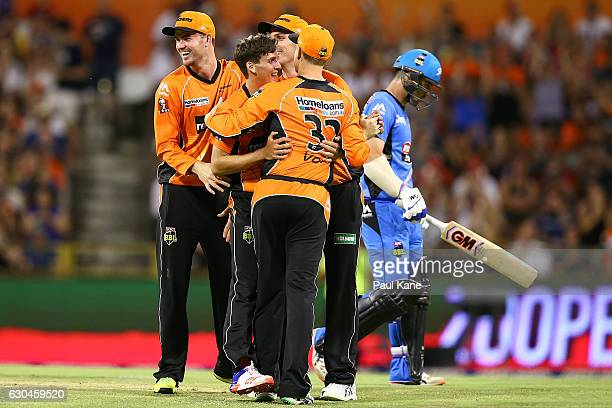 Jhye Richardson of the Scorchers celebrates the wicket of Travis Head of the Strikers during the Big Bash League between the Perth Scorchers and...