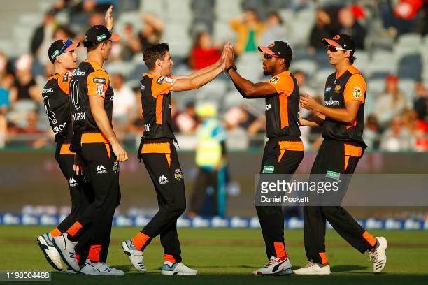 Jhye Richardson of the Scorchers celebrates with Chris Jordan of the Scorchers after combining to dismiss Marcus Harris of the Renegades during the...