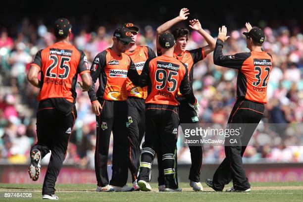 Jhye Richardson of the Scorchers celebrates with team mates after dismissing Daniel Hughes of the Sixers during the Big Bash League match between the...