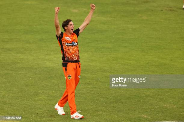 JhyeRichardsonof the Scorchers celebrates the wicket of Brendan Doggett of the Thunder and winning the Big Bash League match between the Perth...