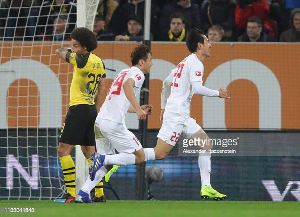 Ji DongWon of Augsburg celebrates scoring his teams first goal during the Bundesliga match between FC Augsburg and Borussia Dortmund at WWKArena on...