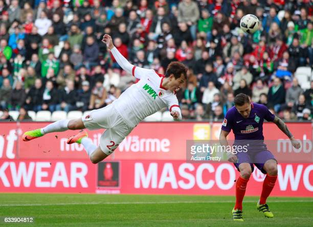 Ji DongWon of Augsburg heads a shot at goal during the Bundesliga match between FC Augsburg and Werder Bremen at WWK Arena on February 5 2017 in...