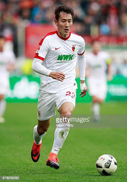 Ji DongWon of Augsburg in action during the Bundesliga match between FC Augsburg and Bayern Muenchen at WWK Arena on October 29 2016 in Augsburg...