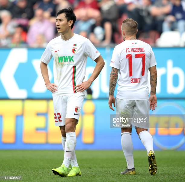 Ji DongWon of Augsburg looks dejected during the Bundesliga match between FC Augsburg and TSG 1899 Hoffenheim at WWKArena on April 07 2019 in...