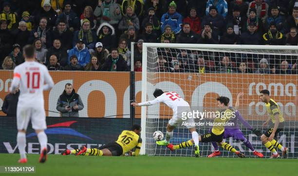 Ji DongWon of Augsburg scores his teams first goal during the Bundesliga match between FC Augsburg and Borussia Dortmund at WWKArena on March 01 2019...
