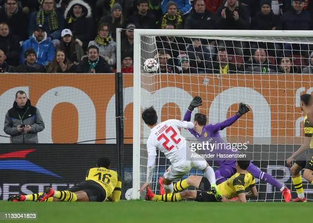 Ji Dong-Won of Augsburg scores his teams first goal during the Bundesliga match between FC Augsburg and Borussia Dortmund at WWK-Arena on March 01,...