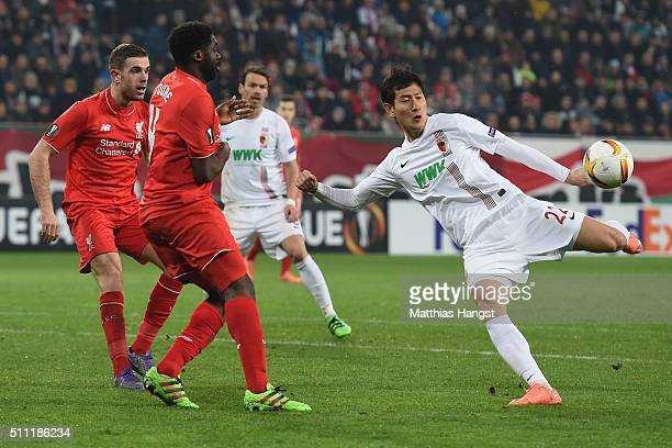 Ji DongWon of Augsburg shoots at goal resulting in hitting a post during the UEFA Europa League round of 32 first leg match between FC Augsburg and...