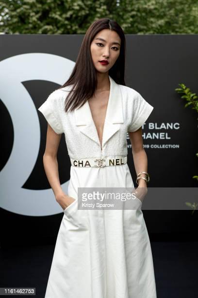 Ji Hye Park attends the Noir et Blanc de Chanel Fall/Winter 2019 Makeup Collection Yachts De Paris on July 11 2019 in Paris France