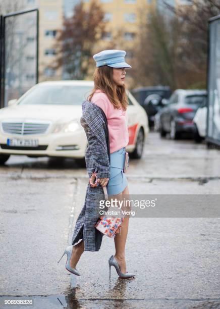 Ji Kim wearing blue military hat pink jumper blue skirt wool coat heels is seen outside Marina Hoermanseder during the Berlin Fashion Week January...