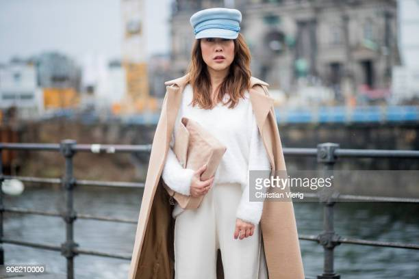 Ji Kim wearing cashmere wool coat custom made blue military hat Fabienne Chapot sweater Zara cropped wide leg pants Zara Louboutin heels Chanel bag...