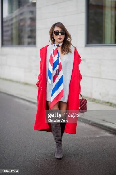 Ji Kim wearing red HM coat silk scarf Balenciaga Zara jumper overknee boots YSL Saint Laurent bag Gucci sunglasses is seen during the Berlin Fashion...