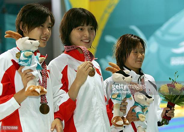 Ji Liping of China poses with her medal during the medal ceremony of the Women's 50m Breaststroke final at the 15th Asian Games Doha 2006 at the...