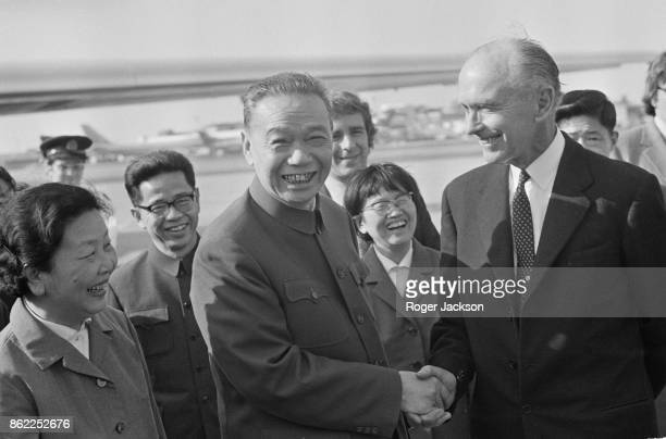 Ji Pengfei the Chinese Foreign Minister and his wife XuHanbing are met by Sir Alec DouglasHome the British Foreign Secretary upon their arrival at...