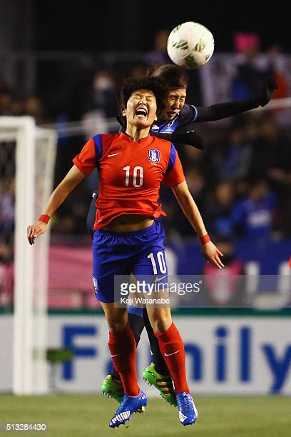 Ji So Yun of South Korea and Yuri Kawamura of Japan compete for the ball during the AFC Women's Olympic Final Qualification Round match between Japan...