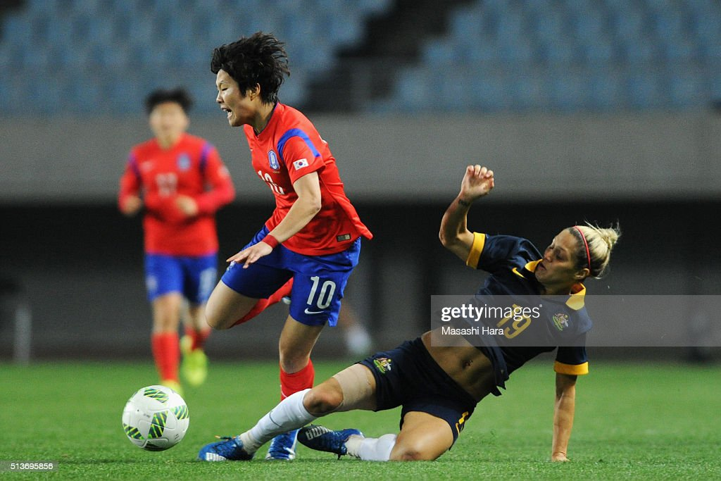 Ji So Yun of South Korea is tackled by Katrina Gorry of Australia during the AFC Women's Olympic Final Qualification Round match between South Korea and Australia at Yanmar Stadium Nagai on March 4, 2016 in Osaka, Japan.