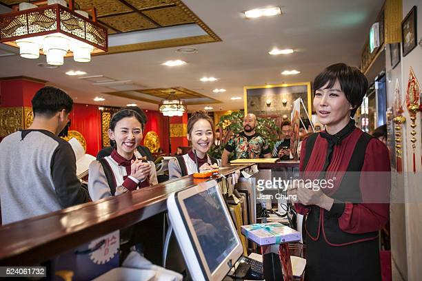 Ji Soowon far right and other actors rehearse on the set of a South Korean TV drama 'Gahwamansasung' or Bong's Happy Restaurant by MBC on April 25...