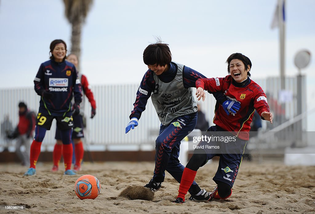 Ji So-Yun (L) and Yukari Kinga of INAC of INAC Kobe Leonessa Ladies duel for the ball during a session at the Club Natacion Barcelona sport complex in La Barceloneta beach on February 5, 2012 in Barcelona, Spain.