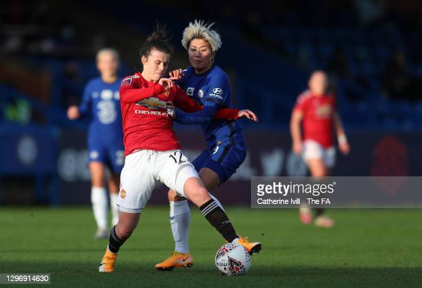 Ji So-Yun of Chelsea battles for possession with Hayley Ladd of Manchester United during the Barclays FA Women's Super League match between Chelsea...