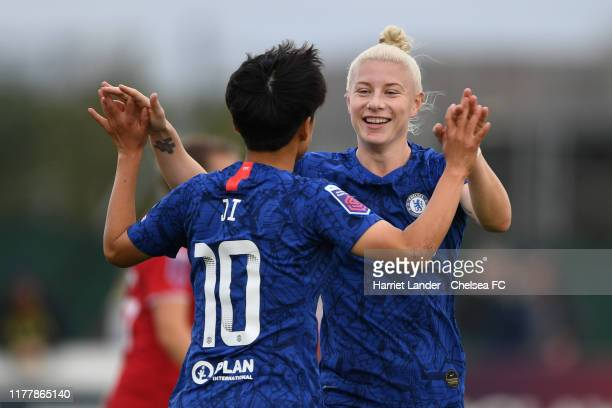 Ji So-Yun of Chelsea celebrates with teammate Bethany England after scoring her team's third goal during the Barclays FA Women's Super League match...