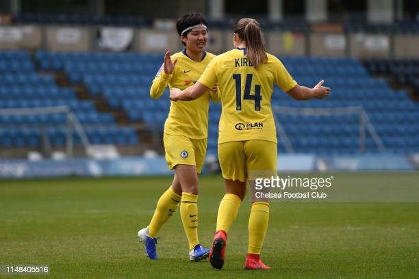 Ji So-Yun of Chelsea celebrates with teammate Fran Kirby after scoring her team's first goal during the WSL Match between Reading FC Women and...