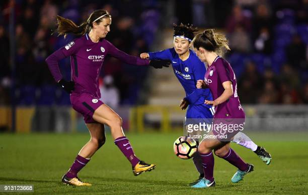 Ji Soyun of Chelsea Ladies is tackled by Abbie Mcmanus and Jill Scott of Manchester City Ladies during the WSL match between Chelsea Ladies and...