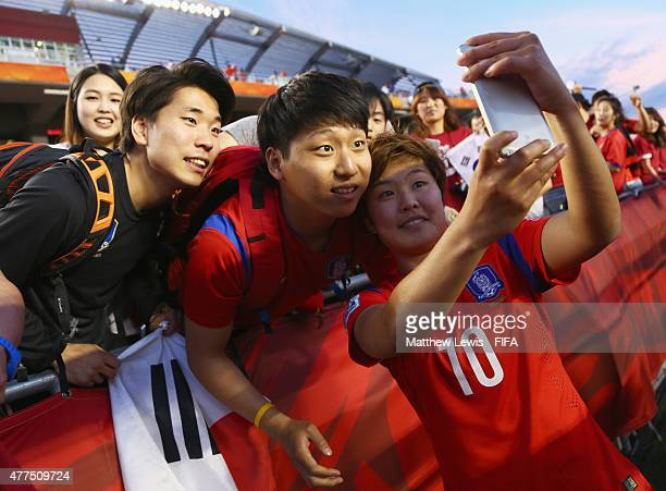Ji Soyun of Korea Republic takes a selfie for fans after the FIFA Women's World Cup 2015 Group E match between Korea Republic and Spain at Lansdowne...