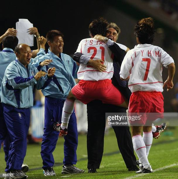 Ji Sung Park of South Korea celebrates with coach Guus Hiddink after scoring the winning goal during the FIFA World Cup Finals 2002 Group D match...