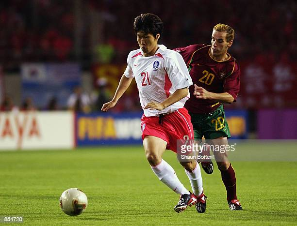 Ji Sung Park of South Korea holds off Petit of Portugal during the FIFA World Cup Finals 2002 Group D match played at the Incheon Munhak Stadium in...