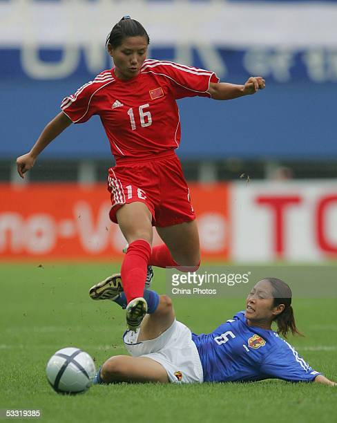 Ji Ting of China vies for the ball with Sakai Tomoe of Japan during a match in the East Asian Football Federation Women's Cup 2005 on August 3, 2005...