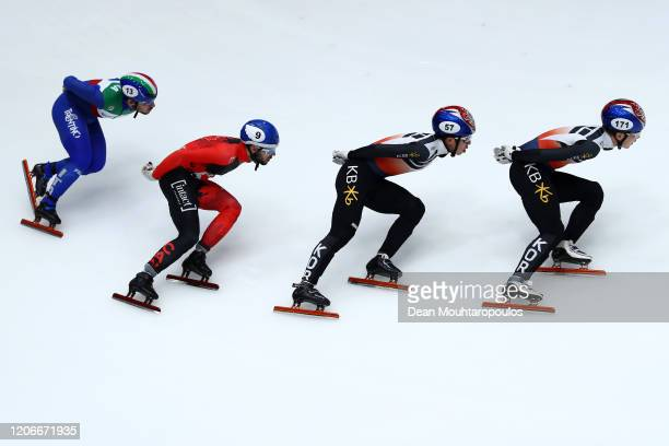 Ji Won Park and Dong Wook Kim both of South Korea, Steven Dubois of Canada and Yuri Confortola of Italy compete in the Mens 1000m Final during the...