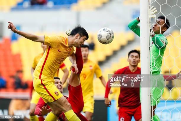 Ji Xiang of China heads the ball during the EAFF E-1 Football Championship match between Hong Kong and China at Busan Asiad Main Stadium on December...