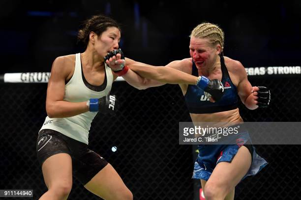 Ji Yeon Kim of South Korea and Justine Kish of Russia throw punches in their flyweight bout during the UFC Fight Night event inside the Spectrum...