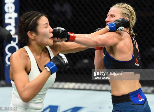 Ji Yeon Kim of South Korea exchanges punches with Justine Kiss in their women's flyweight bout during a UFC Fight Night event at Spectrum Center on...