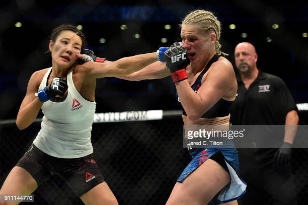 Ji Yeon Kim of South Korea punches Justine Kish of Russia in their flyweight bout during the UFC Fight Night event inside the Spectrum Center on...