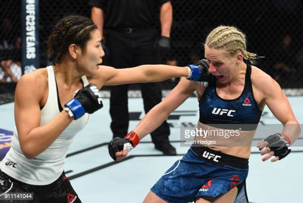 Ji Yeon Kim of South Korea punches Justine Kiss in their women's flyweight bout during a UFC Fight Night event at Spectrum Center on January 27 2018...