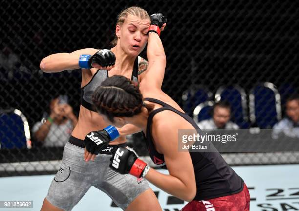 Ji Yeon Kim of South Korea punches Melinda Fábián of Hungary in their women's flyweight bout during the UFC Fight Night event at the Singapore Indoor...