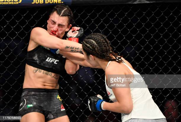 Ji Yeon Kim of South Korea punches Nadia Kassem of Australia in their flyweight fight during the UFC 243 event at Marvel Stadium on October 06, 2019...