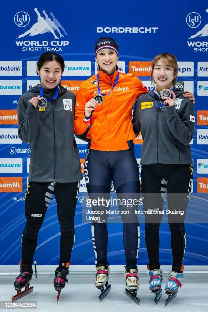 Ji Yoo Kim of Korea Suzanne Schulting of Netherlands and Ah Rum Noh of Korea pose in the Ladies 1500m medal ceremony during day 1 of the ISU World...