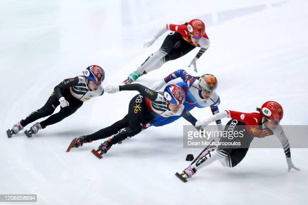 Ji Yoo Kim of South Korea competes and wins the Womens 1000m Final followed by Han Yutong of China and Sofia Prosvirnova of Russia in third during...
