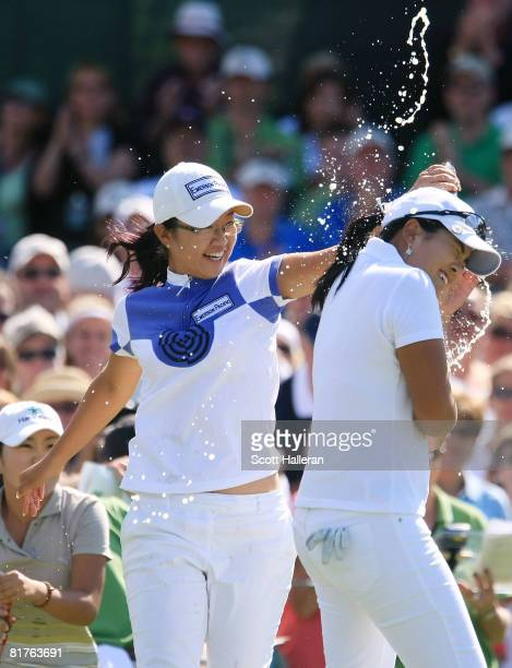 Ji Young Oh of Korea celebrates with InBee Park of Korea winning the 2008 US Women's Open at Interlachen Country Club on June 29 2008 in Edina...