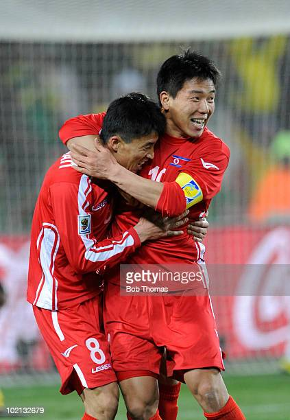 Ji Yun Nam of North Korea is congratulated by teammate Hong Yong Jo after scoring a goal during the 2010 FIFA World Cup South Africa Group G match...