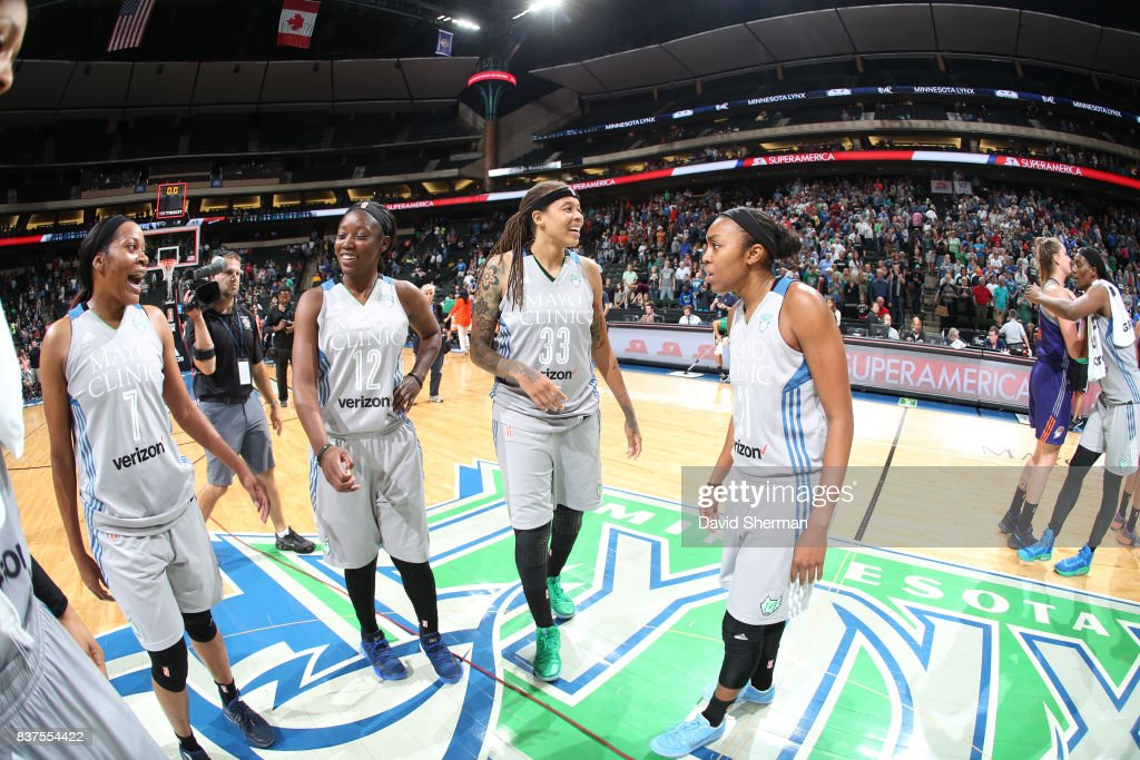 Jia Perkins #7, Alexis Jones #12, Seimone Augustus #33 and Renee Montgomery #21 of the Minnesota Lynx celebrate a win against the Phoenix Mercury on August 22, 2017 at Xcel Energy Center in St. Paul, Minnesota.
