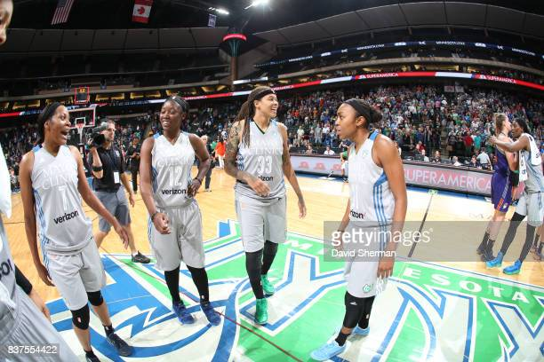 Jia Perkins Alexis Jones Seimone Augustus and Renee Montgomery of the Minnesota Lynx celebrate a win against the Phoenix Mercury on August 22 2017 at...
